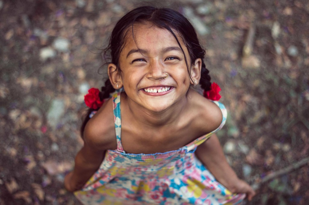 sweet young girl creating smile naturally in Ghasikuwa, Tanahun