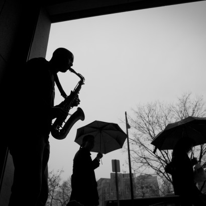 Tim Turner, 30, of Washington, DC, plays his Buescher Aristocrat alto sax for people passing by at the Farragut North Metro Station in Washington, DC, Tuesday, November 29, 2011, as a rain falls. Originally from Richmond, Va, Mr. Turner has been playing the alto sax since age 12. Today he is playing his music here in the nation's capital, and will eventually make his journey cross country to San Francisco, Ca. (Rod Lamkey Jr/ The Washington Times)