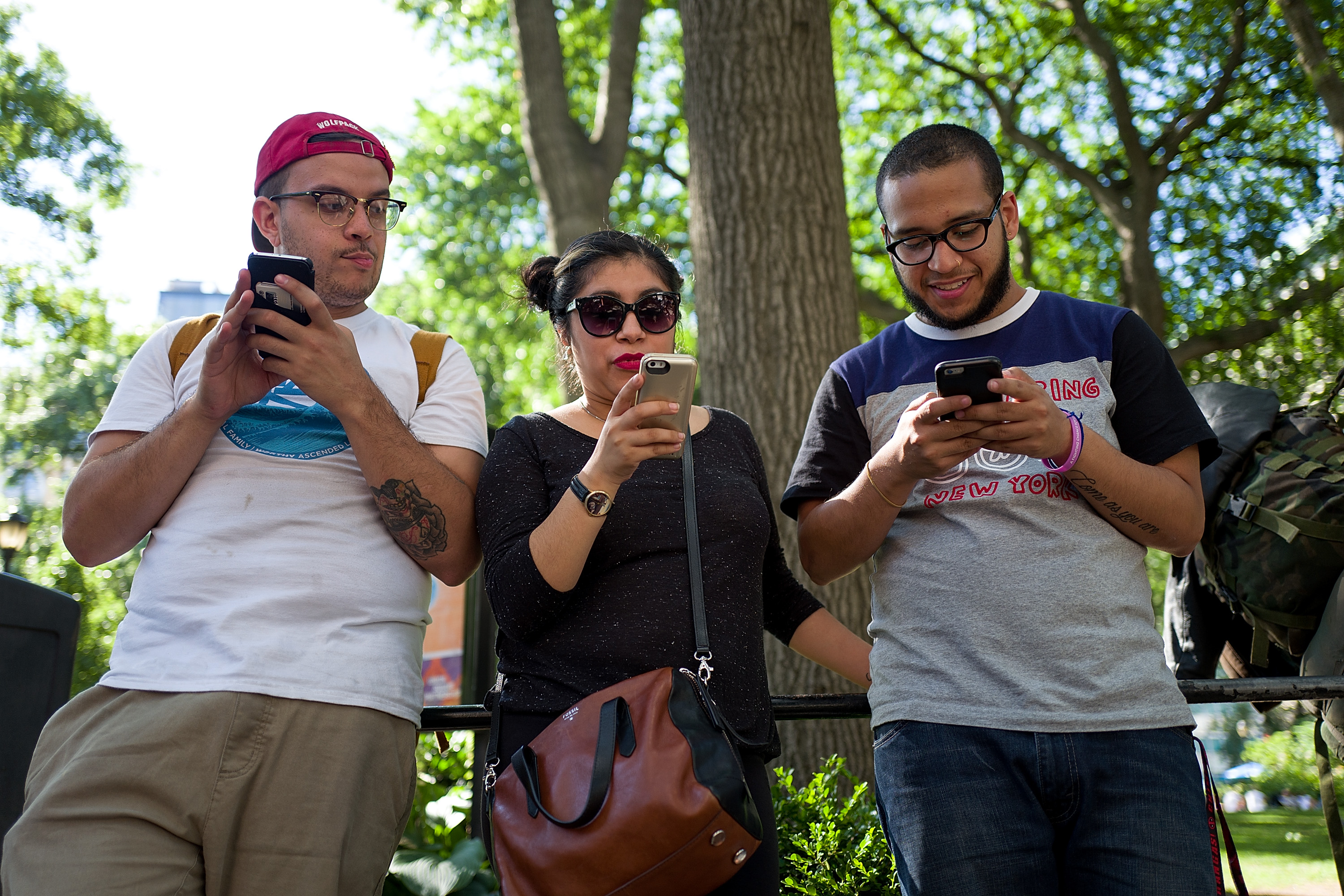 NEW YORK, NY - JULY 11: A group of friends play Pokemon Go on their smartphones at Union Square, July 11, 2016 in New York City. The success of Nintendo's new smartphone game, Pokemon Go, has sent shares of Nintendo soaring. (Photo by Drew Angerer/Getty Images)