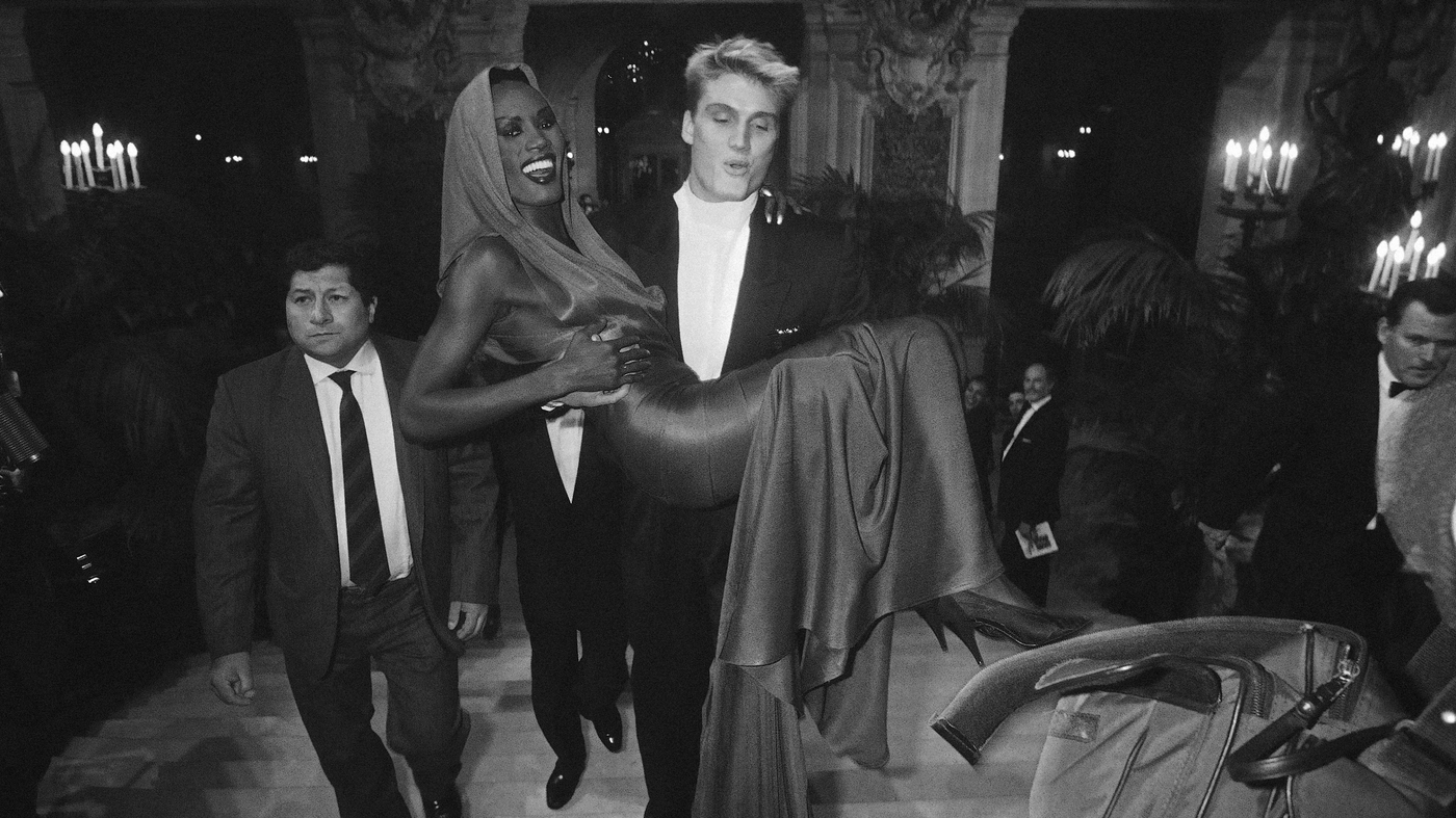 Lundgren carries then-girlfriend Grace Jones to a fashion awards show in Paris in October 1985.