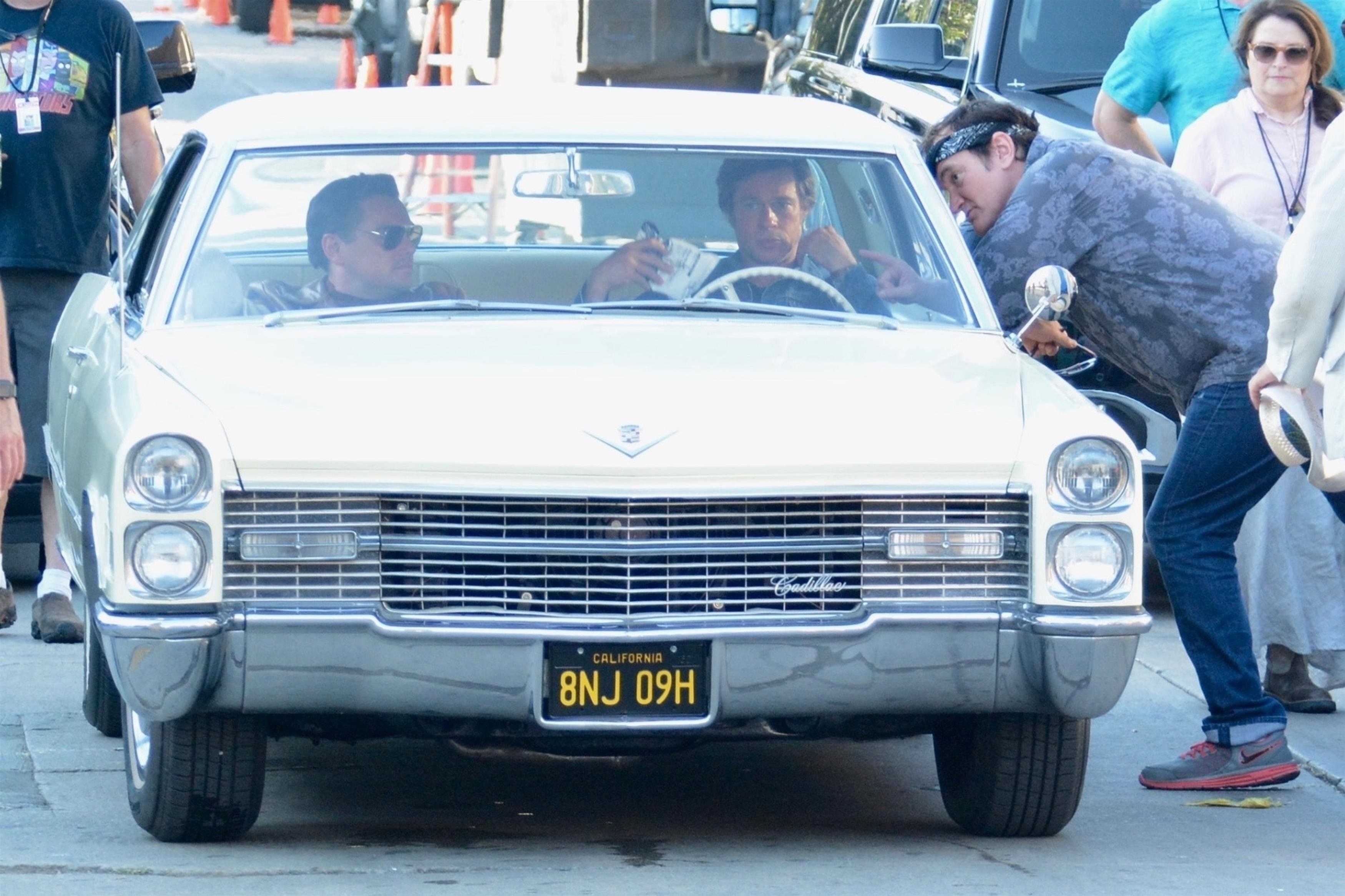 Los Angeles, CA - Leonardo DiCaprio and Brad Pitt were seen on the set of their latest project 'Once Upon a Time In Hollywood' along with director Quentin Tarantino during a busy day of filming in Los Angeles. Pictured: Brad Pitt, Leonardo DiCaprio BACKGRID USA 23 JULY 2018 USA: +1 310 798 9111 / usasales@backgrid.com UK: +44 208 344 2007 / uksales@backgrid.com *UK Clients - Pictures Containing Children Please Pixelate Face Prior To Publication*